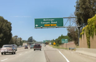 Northbound on 680 freeway exit on the Bollinger Canyon Road exit and make a right turn on to Bollinger Canyon and go to the second traffic light and turn left on Camino Ramon  (if you turn left it is Camino Ramon but if you turn right to the right the sign says Bishop Ranch #1).
